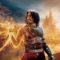 prince-of-persia-the-sands-of-time-the-movie-prince-of-persia-sands-of-time-movie-dastan-a-dagger-sand-city-towers-domes-minarets-the-suns-rays-fire